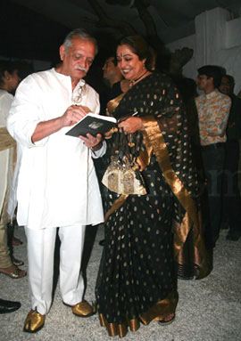 Gulzar saab in white kurta pyjama and his trademark golden mojdis